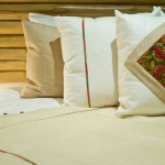 "Custom hand embroidered pillows, throw and ""guayabillo"" wood headboard"